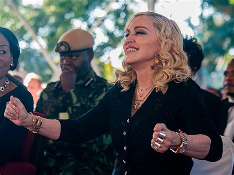 Malawian Judge Postpones Madonna Hearing by Judge Halts Planned Auction Of Madonna S Used
