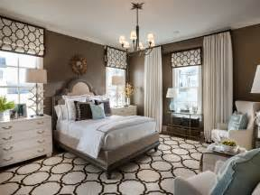 hgtv bedroom decorating ideas transitional style bedroom in brown with blue a bold