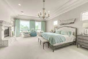 traditional master bedroom with chandelier by green st