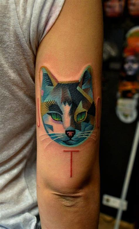 Tattoo Cat Color | abstract color cat head tattoo on bicep