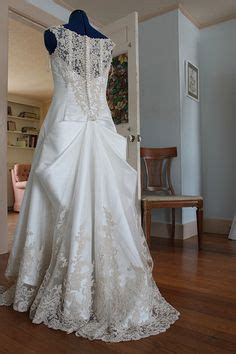 a traditional 4 point bustle in the lace overlay a french