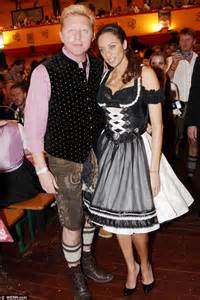 boris becker and wife lilly don traditional dress as they get stuck in at oktoberfest daily
