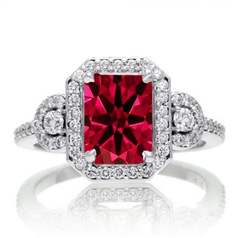 2 carat emerald cut ruby and white halo engagement