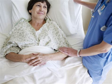 woman in hospital bed fibromyalgia tied to hysterectomy gynecologic disease