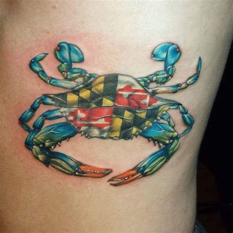 md tattoo blue crab with maryland flag in the middle done by robert