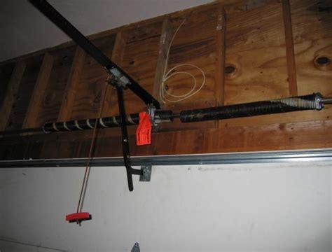 garage door tracks to one side