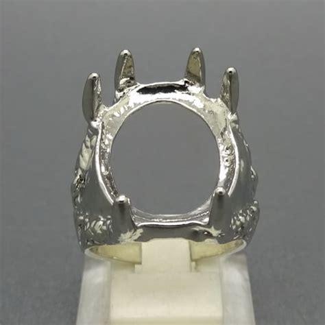 cincin rhoium cangkang motif cakar elang pusaka dunia