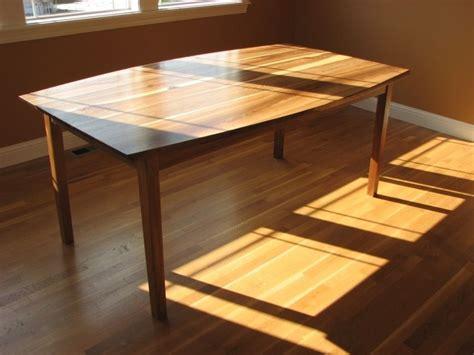 custom elm bow top dining table  poised fine wood art