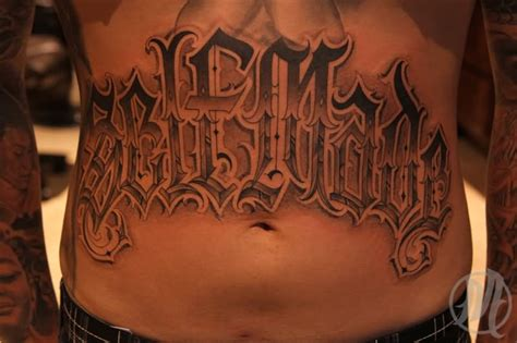 self made tattoo 32 stomach letters
