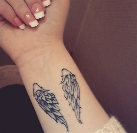 small angel tattoos on wrist small wing on wrist