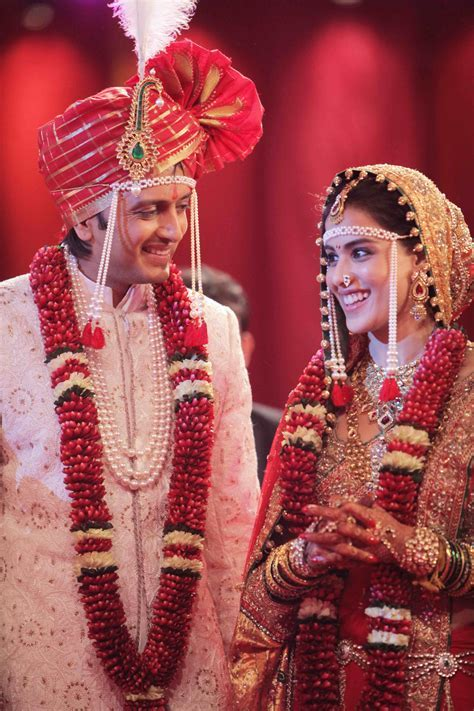 Ritesh Deshmukh & Genelia Desouza in their wedding dresses