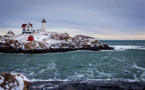 the winter sea sea snow winter coast house lighthouse wallpaper