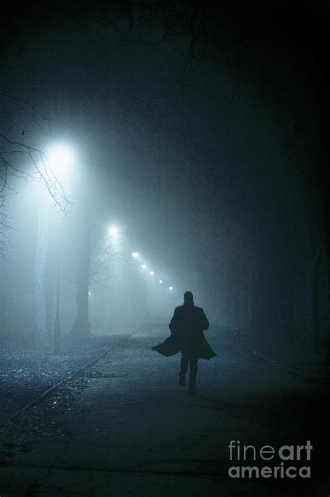 Home Decor Blogs Top man in overcoat running at night in fog photograph by lee