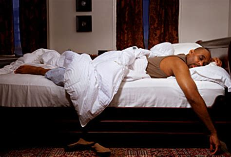 man sleeping in bed 6 amazing tips to help you sleep better in a hotel