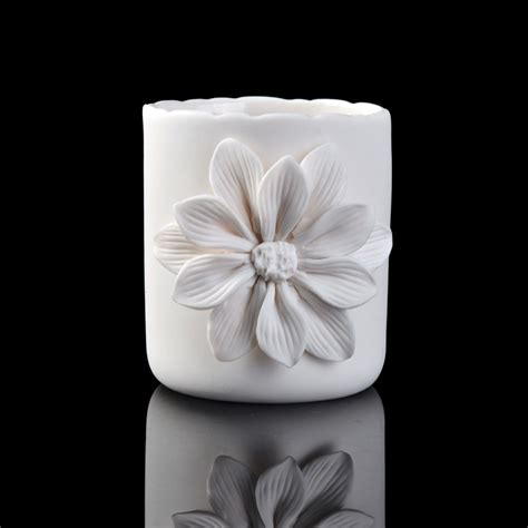 white ceramic flower candle holder on okcandle