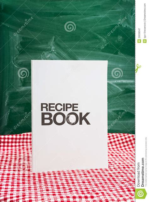 recipe book on a kitchen table royalty free stock
