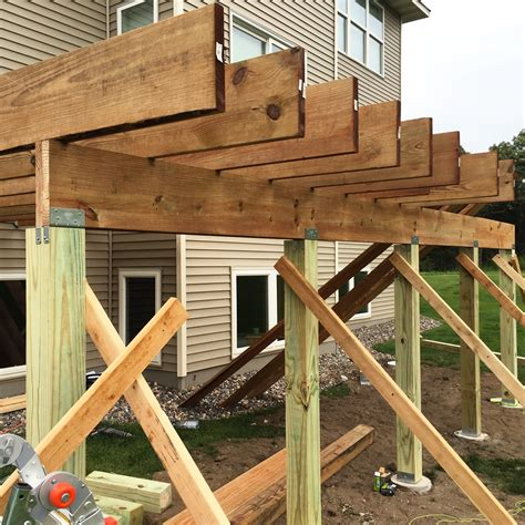 How To Build A Deck by The Pros And Cons Of Hiring A Professional Or Building A
