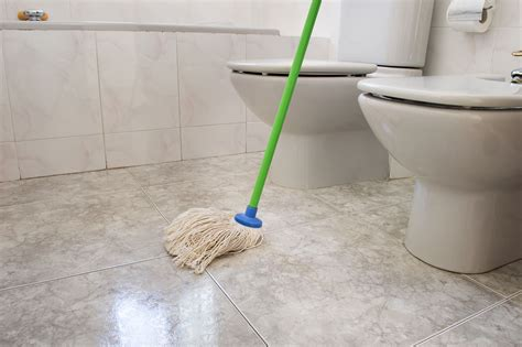 mob the floor how to clean your bathroom in 9 easy steps
