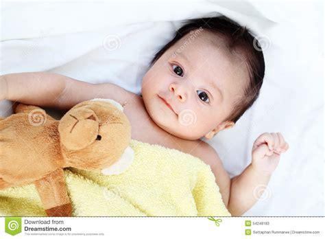 cute baby boy  happy  yellow blanket  doll