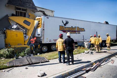 truck driver   hurt  semi crashes  apartment building