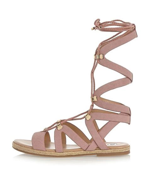 pink lace up sandals river island pink lace up gladiator sandals in pink lyst