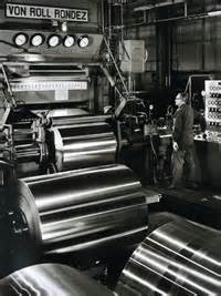 ate aluminum foil worker operating a roll rondez aluminum foil cold rolling machine at alcoa