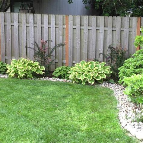 rocks for garden borders we just added river rock border around the yard yard