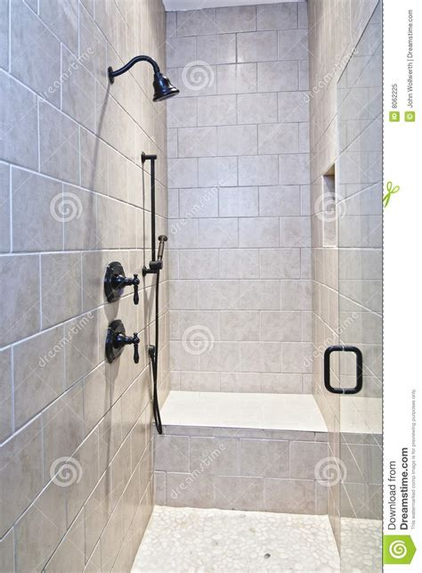 Bath Shower Bench large tile and stone shower royalty free stock photo