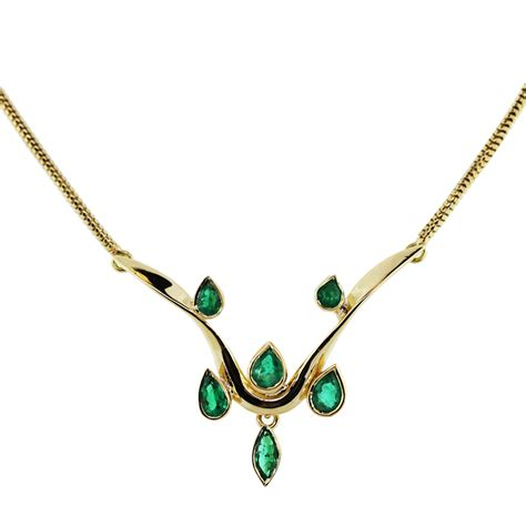 14k yellow gold and emerald necklace with snake chain