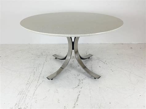 four legged chrome base dining table with white