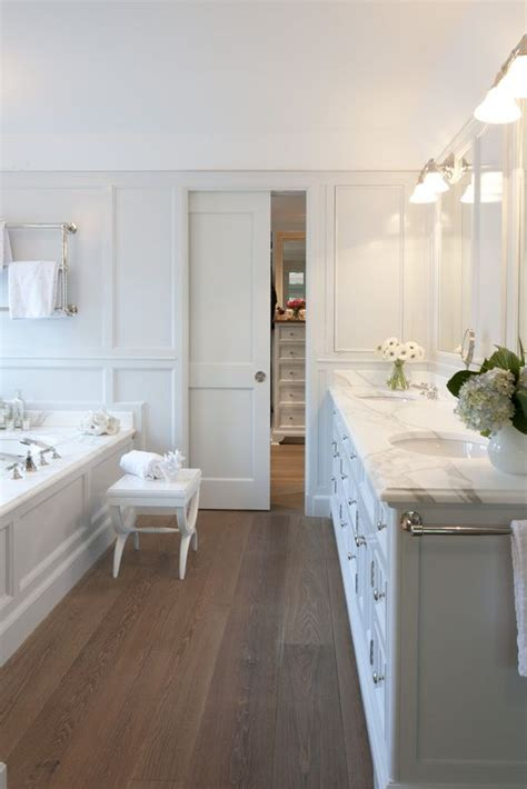 bathroom hardwood flooring ideas white master bathroom with wood flooring and carrara