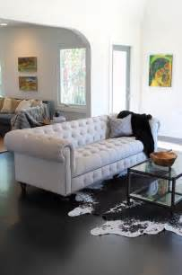 cowhide rug living room cowhide rug and linen chesterfield sofa eclectic living room los angeles by madison