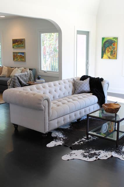 chesterfield sofa in living room cowhide rug and linen chesterfield sofa eclectic