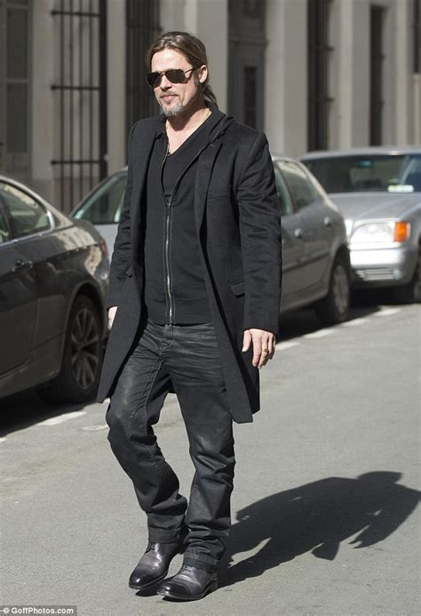 brad pitt takes a leisurely stroll through after his