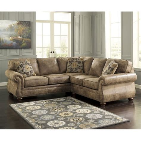 faux leather sectional sofa ashley ashley larkinhurst 2 piece faux leather sectional in earth