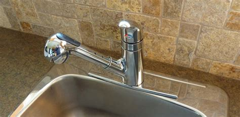 how do you install a kitchen faucet how to install a kitchen sink faucet today s homeowner