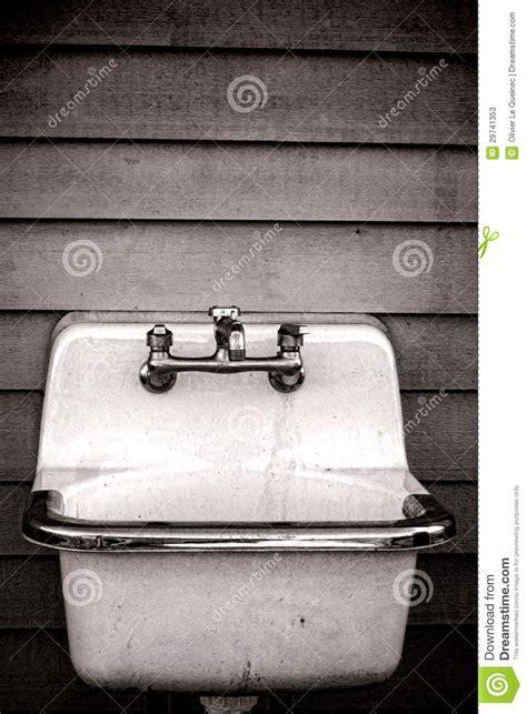 Vintage enamel utility tub sink on old house wall stock photos image 29741353