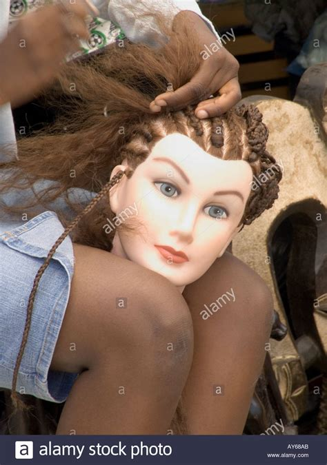mannequin head to practice braiding in st louis girl practicing braiding hair on a mannequins head stock