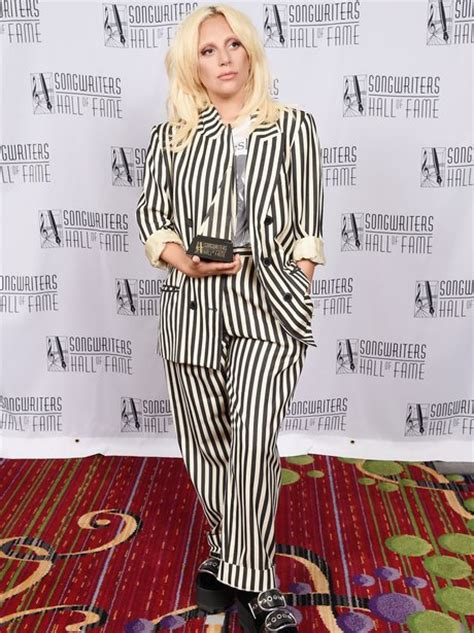 lady gaga accepts contemporary icon award in bra and lady gaga wins the contemporary icon award at the