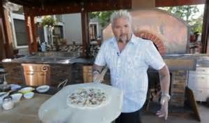 fieri make pizza in his wood fired oven