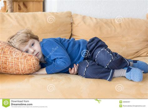 laying couch tired toddler boy laying on couch royalty free stock