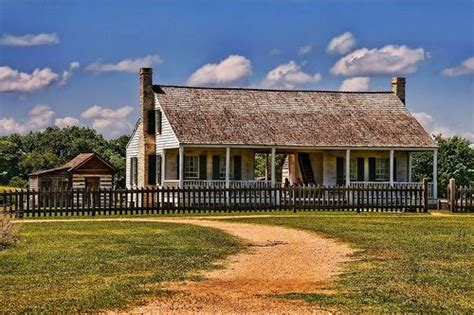 Cracker Style Log Homes dogtrot and separate kitchen the farmhouse exterior