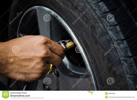 Car Tyres Air Refilling Air Into A Car Tyre Royalty Free Stock Photos