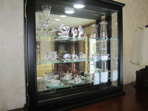 black lighted wall curio cabinet wall shelves