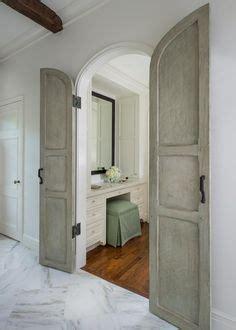 master bathroom  arched bi fold doors transitional