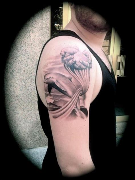 silver needle tattoo shoulder realistic dolphin by silver needle