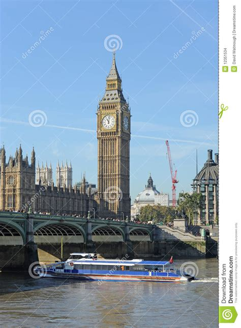 boat tower bridge to westminster tourist boat sailing under westminster bridge stock