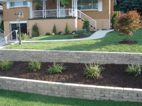Unilock Retaining Wall Retaining Wall Installation By Woehler Landscaping Serving