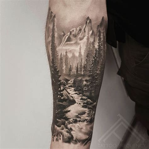 mountain tattoo sleeve completely healed black and gray landscape on mans