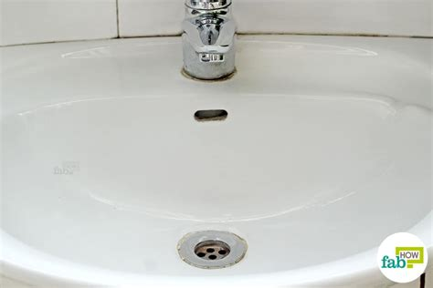 How To Clean White Porcelain Kitchen Sink How To Clean A White Porcelain Sink And Restore Its Shine Fab How